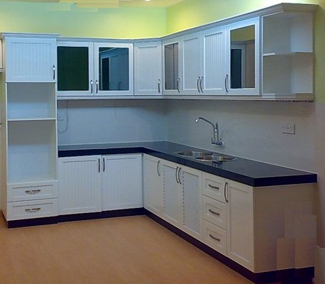Above Picture Is A White Colour L Shaped Dry Kitchen Area